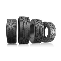 Four car tires isolated on a white background.