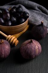 Figs and grapes. Dark still life