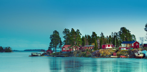 Fisherman village in Sweden at winter after sunset - winter seasonal scandinavian background