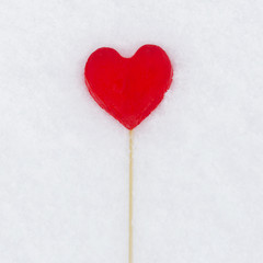 candy in the shape of a heart in the snow