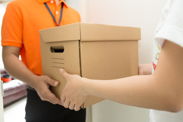 Customers receive goods from delivery man