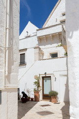 Locorotondo (Puglia, Italy) - View of the little picturesque village in south Italy. The white color of its houses represents the background of its baroque architecture built using the local stones.