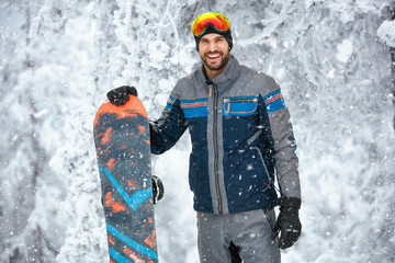 Portrait of male snowboarder on the mountain