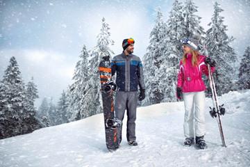 Skiing, winter, ski holiday - Couple on winter vacation