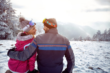 couple in love enjoying on winter vacation together on the mountain