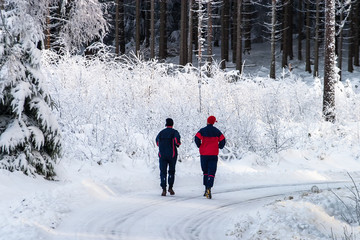 Man and woman running in a winter landscape