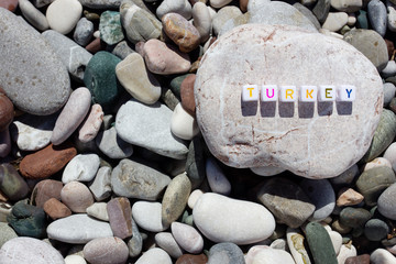 The word Turkey on the pebbles on the sea shore