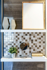 Wooden wall shelf with decorative items in bathroom interior