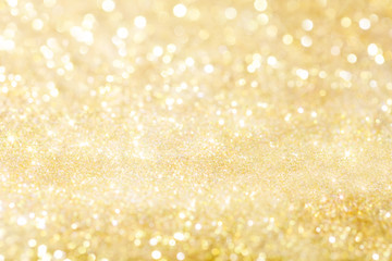Golden holiday background bokeh. Abstract background.