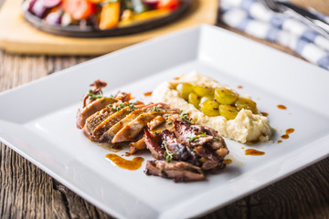 Pheasant breast and thigh roasted with mashed potatoes and grill vegetable. Delicious portion pheasant on plate in hotel or restaurant