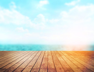 Wood table top on blur sea background. Summer, nature concepts. For montage product display or design key visual layout.