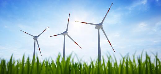 3 Windräder mit Gras