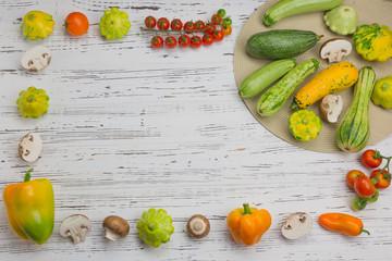 Fresh vegetables on white wood background. Mockup for menu or recipe