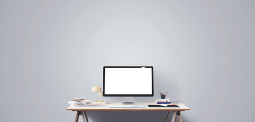 Computer display and office tools on desk. Desktop computer screen isolated. Modern creative workspace. Front view.