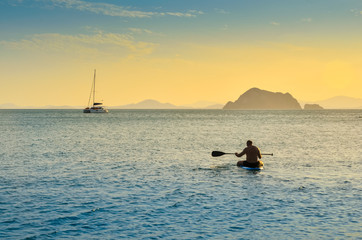 Paddle man in the sea Evening orange sky holiday