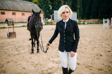 Equestrian sport, female jockey and horse