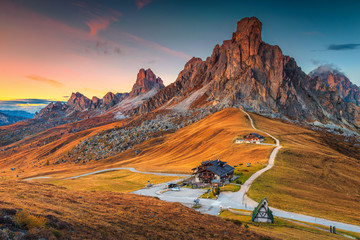 Wall Mural - Majestic alpine pass with high peaks in background, Dolomites, Italy