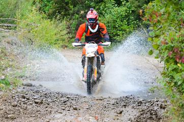 Offroad motorbike crossing river