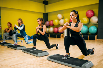 Women group on step aerobic workout