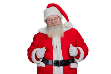 Real bearded Santa Claus on white background. Old kind Santa Claus standing on white background. Positive and happy realistic Santa Claus, studio shot.