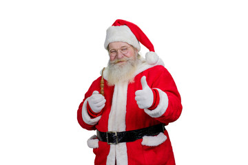 Santa with pipe giving thumb up. Authentic Santa Claus with real beard and giving thumb up, isolated on white background. Portrait of Santa with ok geture.