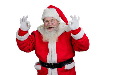 Santa showing ok sign, white background. Joyful Santa Claus making okey sign with both hands on white background.