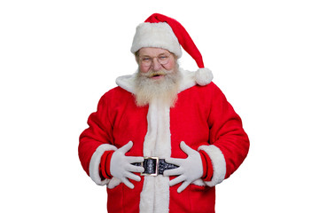 Old Santa with hands on belly. Portrait of realistic Santa Claus holding hands on belly and looking at camera. Authentic Santa Claus, studio shot.