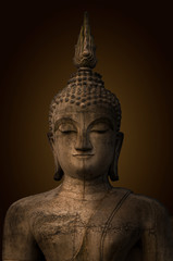 Buddha statue used as amulets of Buddhism religion.The ancient Buddha, dark brown background.
