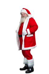 Senior Santa Claus standing on white background. Old authentic Santa Claus in eyeglasses isolated on white background, studio shot.