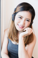 beautiful Asian Woman enjoy happy and laught  Cheerful with headphone Portrait Concept