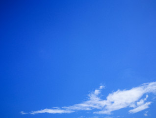 Soft white clouds against blue sky background and empty space for your design.