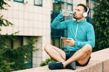 Man is relaxing after jogging