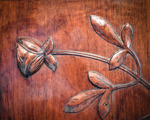 Leaves and flowers carved in the wood.