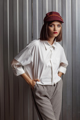 Wall Mural - Young woman posing in a costume. Fashion makeup