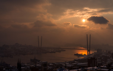 Wall Mural - Vladivostok cityscape with dramatic sunset sky.