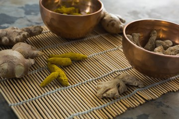Ginger and turmeric stick on bamboo placemat