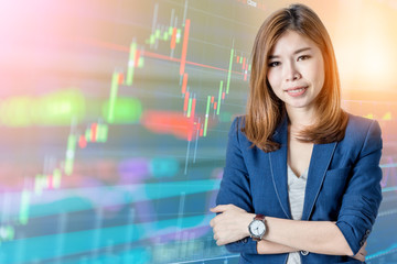 beautiful asian business woman with Candle stick graph chart of stock market investment trading