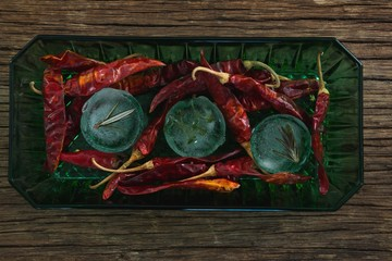 Flavored ice cubes with herb and dried red chili pepper
