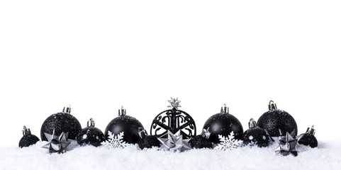 Black christmas balls with snow isolated on white background Fototapete