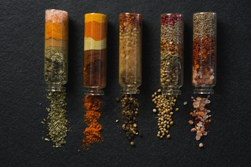 Various spices spilled out of jar