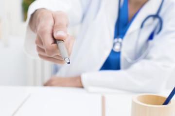 doctor with pen to sign the contract