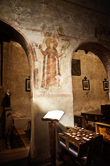 Interior with medieval frescoes of antique Santa Maria Assunta church, Old Muggia, Italy in romanesque style built in 10th-13th century