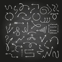 Arrows on black chalkboard