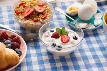 Continental breakfast menu on checkered cloth