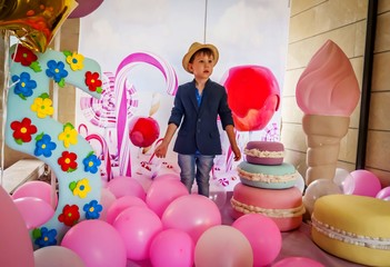 Cute Caucasian boy at a girl's birthday party, feeling confused, gender issues stock image.