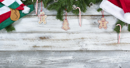 Christmas fir branches along with traditional decorations on rustic white wooden background