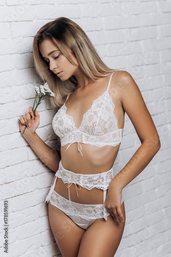 6d49567dcf7 Sexy woman in underwear posing. Beautiful girl in white wedding lingerie.