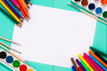 bright colors, pencils and school supplies on the table
