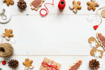 Christmas background. Christmas gift with christmas decorations on the wooden white table.