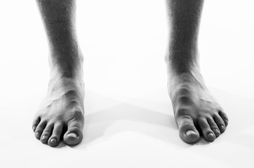 Black and white barefoot male feet